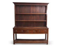 Late Georgian mahogany oak dresser having a two-shelf panelled back, the base section of three