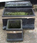 Pair of modern black painted garden planters of rectangular form on stepped bases, 74cm wide,