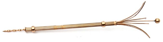 9ct gold double ended cigar piercer and swizzle stick, the engine turned barrel with two sliding