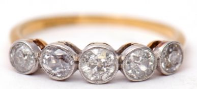 Five stone diamond ring featuring five old cut diamonds, each in millegrain settings and raised in a