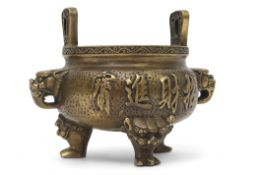 Chinese bronze censer, the handles modelled as stylised dragons heads, the body and base with
