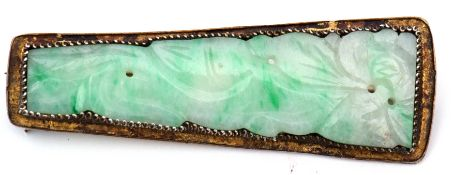 Antique Chinese carved jade brooch, the elongated shaped panel carved with a foliate and squirrel