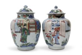 Pair of Chinese porcelain Wucai jars and associated covers, probably transitional period, the jars