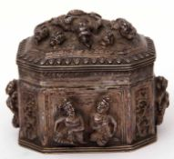19th century Indian white metal lidded box of sarcophagus form, the sides and lid heavily embossed
