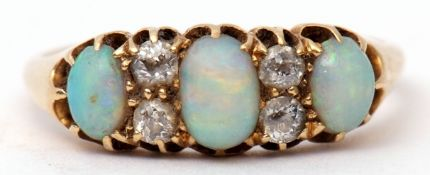 Late Victorian opal and diamond ring featuring three graduated oval cabochon opals highlighted
