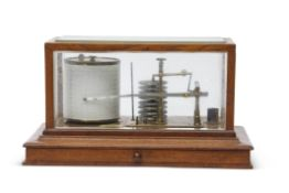 Early 20th century brass barograph with metal bellows housed in a glass panelled mahogany case