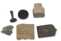 Group of Seljuk seals and intaglios, Persian, probably 11th/12th century, including two bronze
