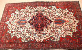 Early 20th century Oriental silk/wool carpet, triple gull border and central floral lozenge,