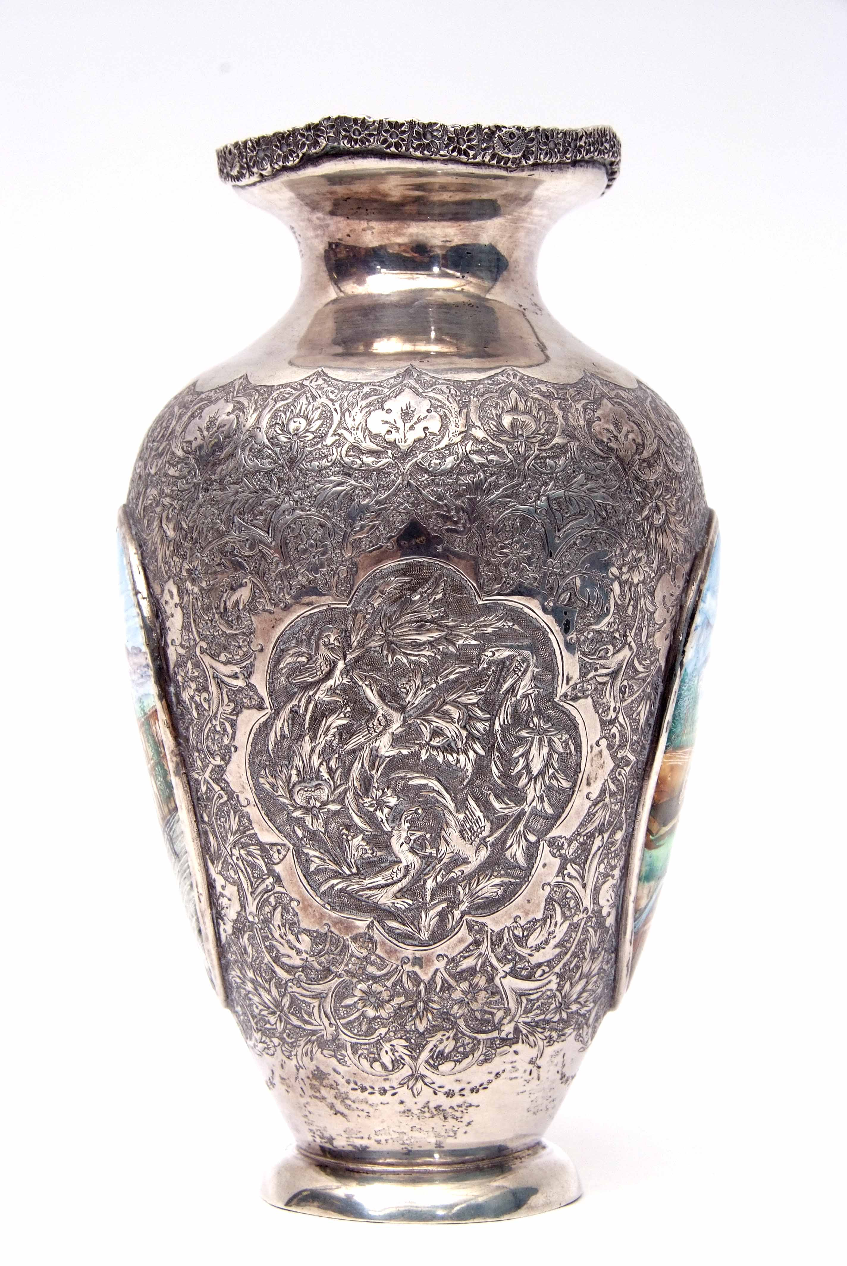 Lot 413 - An interesting Russian white metal vase, heavily chased with bird and foliate designs and also