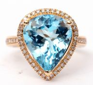 Blue topaz and diamond ring, a pear cut blue topaz, approx 7.48ct set within a diamond surround,