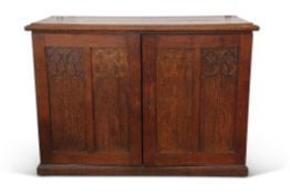 Wall fitting oak collector's cabinet having moulded edge top above two panelled doors with (partial)