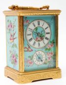 Last quarter of 19th/1st quarter of 20th century ornate brass and glass cased carriage clock