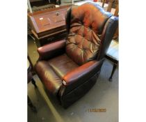 AN OX-BLOOD LEATHER AND BUTTON BACK RECLINER LAZYBOY ARMCHAIR