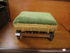 WALNUT FRAMED GREEN DRALON UPHOLSTERED SQUAT STOOL WITH SPINDLE SUPPORTS