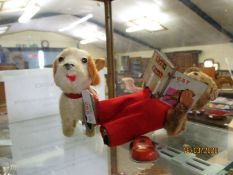 GOOD QUALITY MODERN CLOCKWORK BEAR READING A BOOK AND A FURTHER CLOCKWORK MODEL OF A DOG