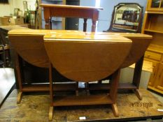 THREE SMALL OAK DROP LEAF TABLES WITH PLANKED ENDS