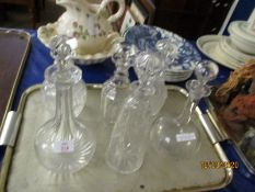 SIX ASSORTED GLASS DECANTERS