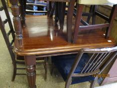 19TH CENTURY MAHOGANY EXTENDING DINING TABLE WITH TURNED AND FLUTED LEGS RAISED ON PORCELAIN CASTERS
