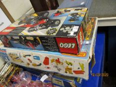 FIVE SETS CONTAINING LEGO, AURORA WORLD CHAMPION MOTOR RACING, MATCHBOX, CONTAINER PORT PART SET