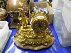 FRENCH GILT SPELTER MANTEL CLOCK WITH ENAMELLED ARABIC CHAPTER RING ON AN ONYX BASE