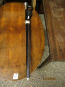 SILVER PLATED TOP AND EBONISED WALKING CANE AND A FURTHER EASTERN HARDWOOD CARVED WALKING STICK (2)