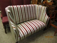 EDWARDIAN MAHOGANY FRAMED TWO SEATER COTTAGE SOFA WITH CREAM, RED AND GOLD STRIPED UPHOLSTERY