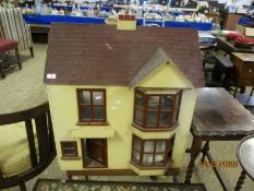 VICTORIAN PAINTED DOLLS HOUSE AND WHEELED STAND