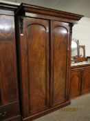 VICTORIAN MAHOGANY DOUBLE DOOR CUPBOARD WITH CARVED DETAIL