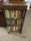 NARROW OAK OPEN FRONTED BOOKCASE WITH TWO SHELVES AND A QUANTITY OF VINTAGE BOOKS