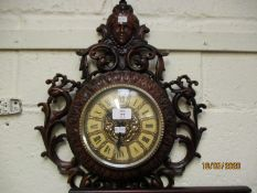 PLASTIC FRAMED OPEN WORK WALL CLOCK WITH FIGURE MOUNTED TOP
