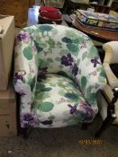 EDWARDIAN FLORAL UPHOLSTERED TUB CHAIR WITH CABRIOLE FRONT LEGS RAISED ON BRASS CASTERS