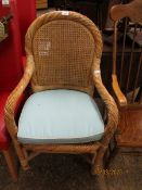 WICKER ARMCHAIR WITH TURQUOISE UPHOLSTERED CUSHION