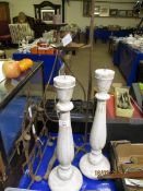 TWO WHITE PAINTED CANDLE STICKS, TWO TWISTED METAL CANDLE STICKS AND A FURTHER WALL HANGING (5)