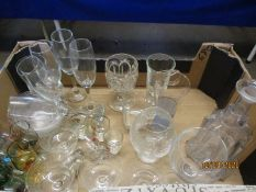 BOX OF MIXED GLASS WARES, DECANTERS, CHAMPAGNE FLUTES, ETC