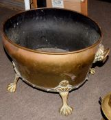 Brass two-handled oval planter applied with lion mask ring handles and raised on paw feet, 18cm long