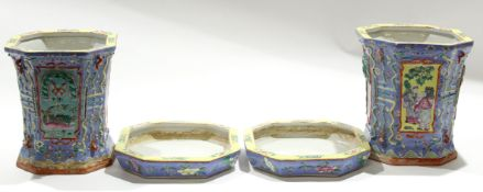 Group of two Chinese porcelain jardinieres and stands decorated in polychrome on a blue ground