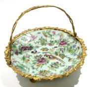 Late 19th century Canton plate with gilded metal mounts and handle, 27cm diam