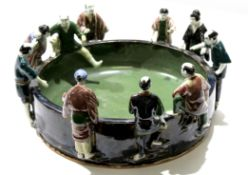 Unusual Japanese pottery bowl, the rim surrounded by ten Japanese figures in various poses,