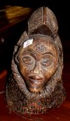 Collection of five various tribal Oriental carved wooden hardstone and composition busts etc,