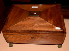 Early 19th century mahogany work box of sarcophagus form, with fitted lift out tray, rosewood