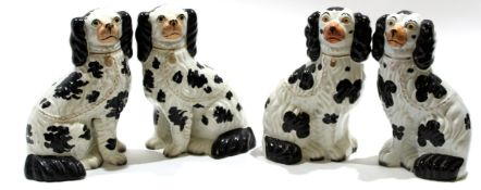 Group of four Staffordshire spaniels all with typical black sponged decoration (4)