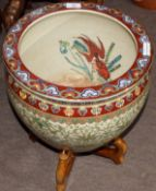 Chinese porcelain fish bowl with a scrolling design in green enamel below a polychrome rim mounted