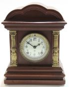 Early 20th century mantel clock with shaped brass pillars with white enamel dial white gilt