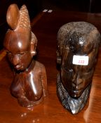 Two African hardwood busts, 23cm and 30cm high (2)