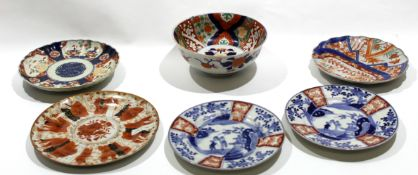 Group of Japanese porcelain wares including three Arita plates with blue and white designs and