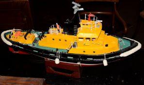 Painted composition model of a tug on stand, length 74cm x 44cm high (including stand)