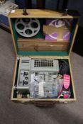 Ditmar vintage movie projector in a light oak case