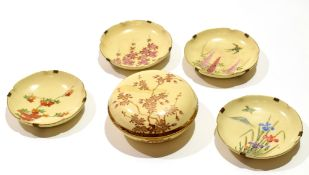 Group of four Satsuma dishes of lobed shape with typical designs together with a circular bowl and