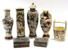 Group of Oriental pottery crackleware vases, one with cover, all with typical designs including a