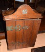 "Vintage oak wall mounting cabinet, the pediment inscribed ""Walker of Catford"", 30cm wide"